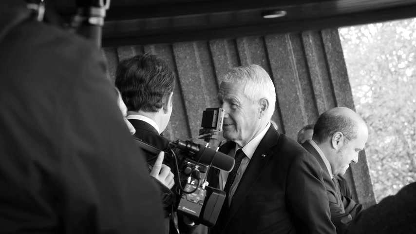coe : STRASBOURG, FRANCE - OCT 31, 2017: Thorbjorn Jagland Secretary General of the Council of Europe waiting for the French President Emmanuel Macron at Council of Europe, black and white
