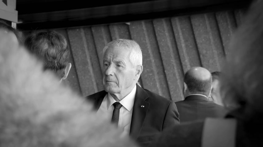 french president : STRASBOURG, FRANCE - OCT 31, 2017: Thorbjorn Jagland Secretary General of the Council of Europe waiting for the French President Emmanuel Macron at Council of Europe, black and white