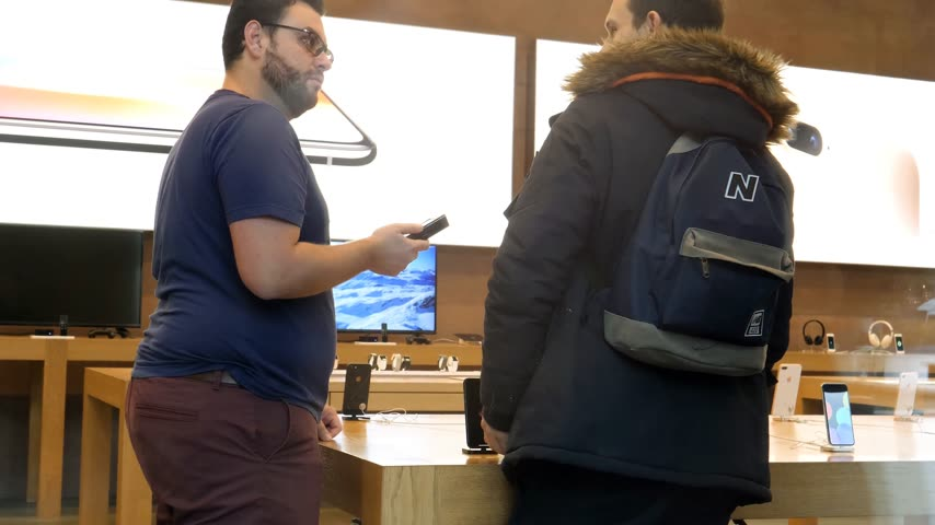 jel : STRASBOURG, FRANCE - NOV 3, 2017: View from the street of Genius Team helping with purchase of the latest Apple iPhone X goes on sale in Apple Store worldwide