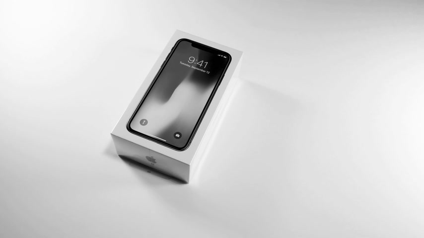 jel : PARIS, FRANCE - NOV 3, 2017:  unboxing of the latest Apple iPhone X 10 smartphone in white studio background black and white