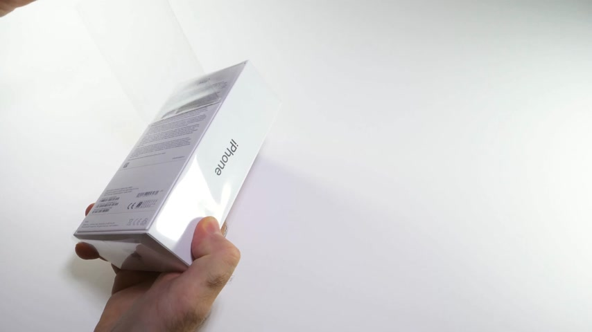 jel : PARIS, FRANCE - NOV 3, 2017: Man preparing for the unboxing of the latest Apple iPhone X 10 smartphone in white studio background time-lapse fast motion