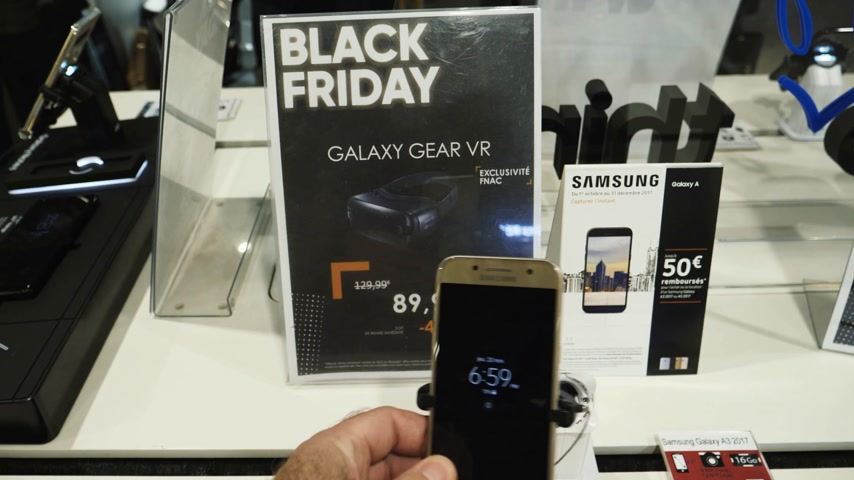 off : PARIS, FRANCE - CIRCA 2017: POV point of view of male buying Samsung Galaxy Android smartphone with special offer during Black Friday inside FNAC French technology retail store Stock Footage