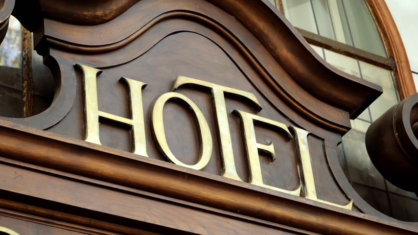 отель : Luxury vintage Hotel inscription with golden letters on the facade of five star hotel in Spain, Europe Стоковые видеозаписи