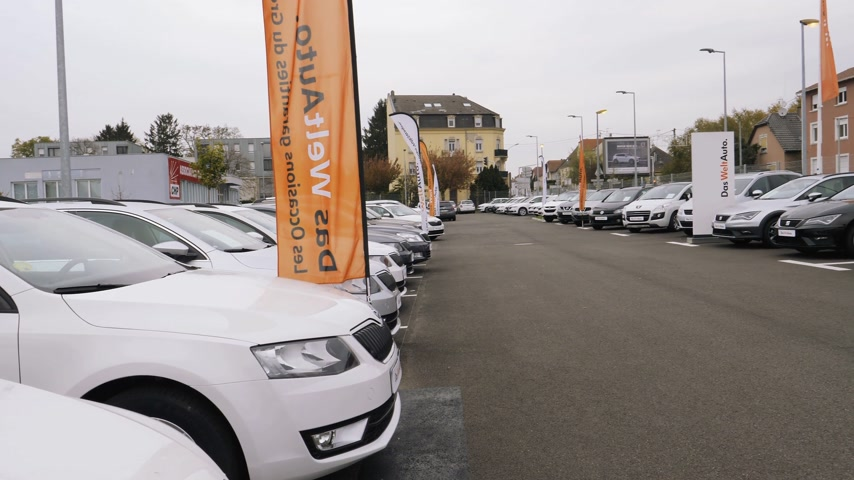 superb : STRASBOURG, FRANCE - CIRCA 2017: Pan over rows of new and used cars of Skoda Brand by Volkswagen on sale at car dealership with diverse models from Superb to Octavia and Fabia - Das Welt Auto Stock Footage