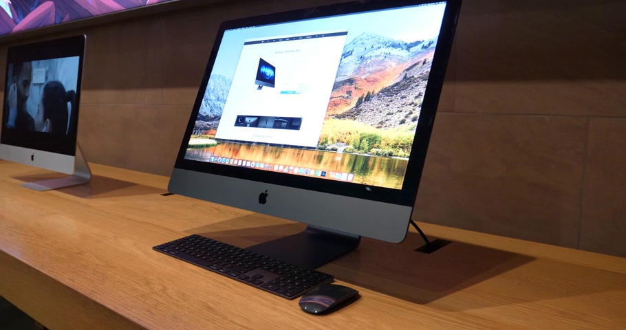 apple workstation : STRASBOURG, FRANCE - JAN 11, 2018: New iMac Pro the all-in-one personal computer in Apple Computers Store. Apple claims the iMac Pro is the most powerful Mac ever made - slow rotation presentation
