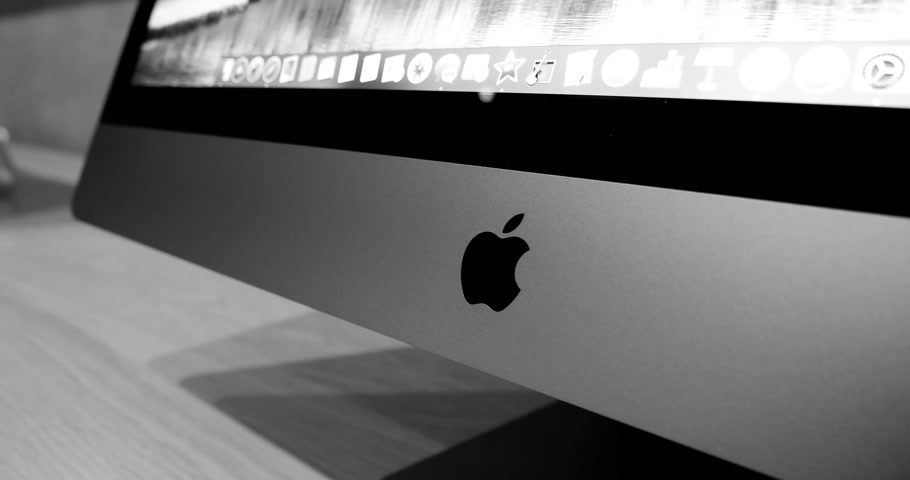 intel : STRASBOURG, FRANCE - JAN 11, 2018: Detail of Apple logo on the new iMac Pro the all-in-one personal computer in Apple Computers Store. Apple claims the iMac Pro is the most powerful Mac