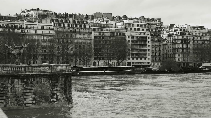 french metro : View from Pont de Bir-Hakeim of French architecture and swollen river Seine embankments overflow flooding in Paris - news footage black and white