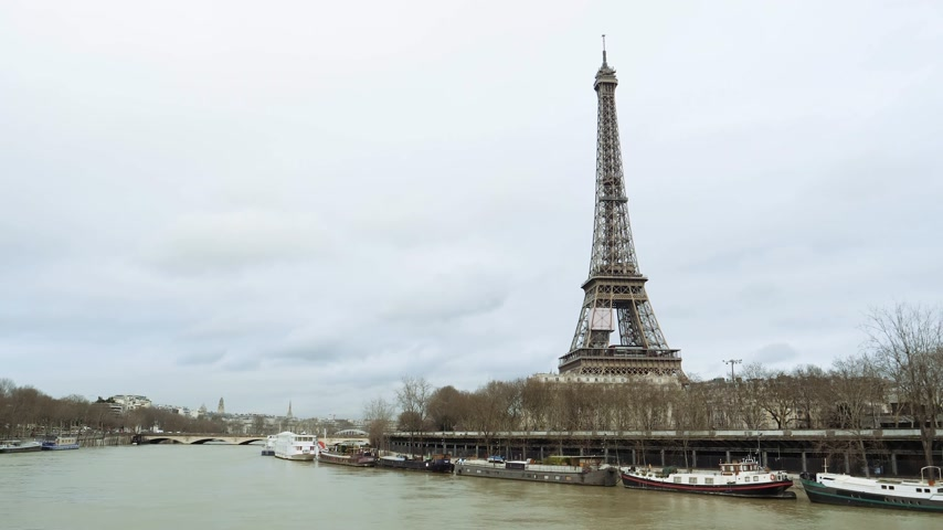 bir hakeim bridge : Eiffel Tower in Paris view from still drone on the middle of the Seine River during floods overflowing