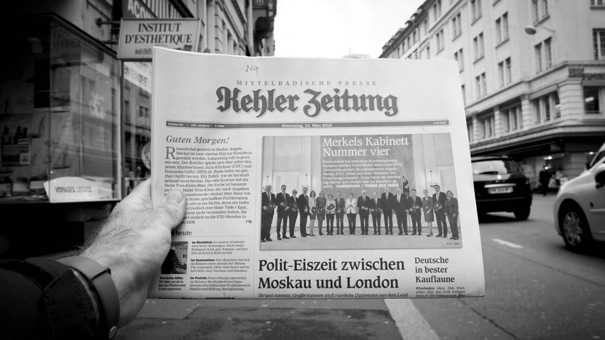 buy newspaper : PARIS, FRANCE - MAR 15, 2017: Man reading buying German Kehler Zeitung newspaper at press kiosk featuring Angela Dorothea Merkel re election as Chancellor of Germany team black and white