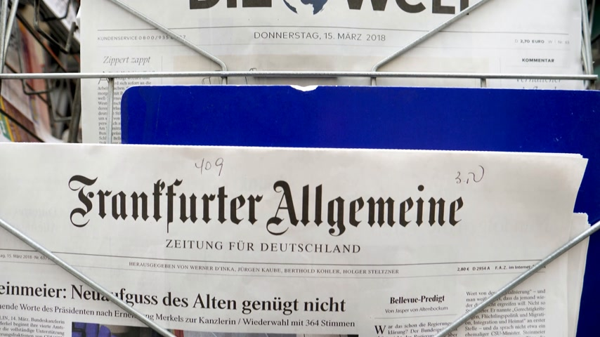 chancellor : PARIS, FRANCE - MAR 15, 2017: Tilt-down to German Frankfurter Allgemeine Zeitung newspaper at press kiosk featuring Angela Dorothea Merkel re election as Chancellor of Germany