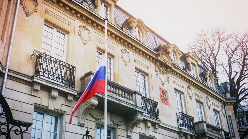 flag half mast : STRASBOURG, FRANCE - MAR 28, 2018: Flag of Russia flying half-mast ar Russian Consulate Embassy - tribute and mourning of victims of fire at Zimnyaya Vishnya  shopping centre Kemerovo - cinematic