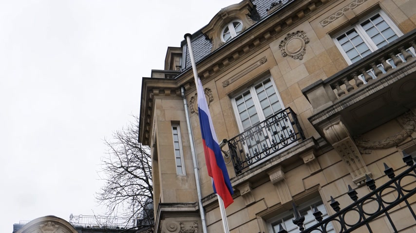 symbol of respect : STRASBOURG, FRANCE - MAR 28, 2018: Flag of Russia flying half-mast ar Russian Consulate Embassy - tribute and mourning of victims of fire at Zimnyaya Vishnya  shopping centre Kemerovo  view from below