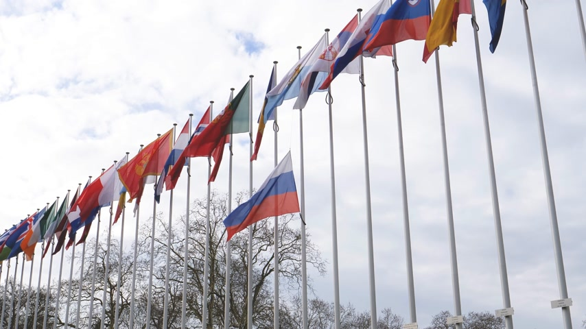 national day of mourning : STRASBOURG, FRANCE - MAR 28, 2018: Flag of Russia flying half-mast at Council of Europe - tribute and mourning of victims of fire at the shopping centre Kemerovo