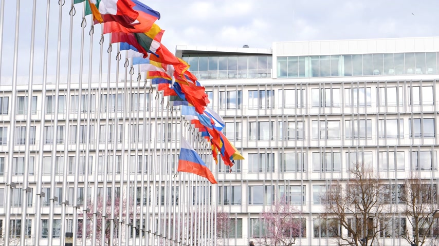 flag half mast : STRASBOURG, FRANCE - MAR 29, 2018: Zoom-out from Council of Europe with Flag of Russia flying half-mast as tribute and mourning of victims of fire at shopping centre Kemerovo