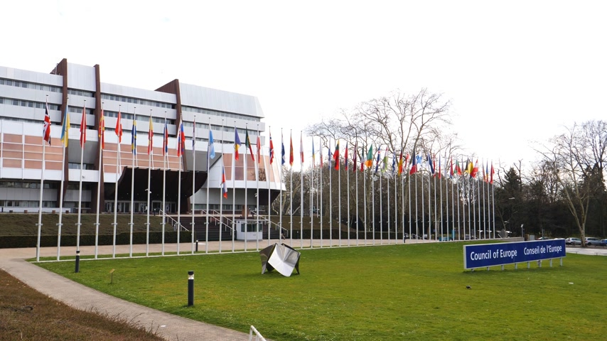 flag half mast : STRASBOURG, FRANCE - MAR 29, 2018: Aerial view Council of Europe building with Flag of Russia flying half-mast as tribute and mourning of victims of fire at Zimnyaya Vishnya shopping centre Kemerovo