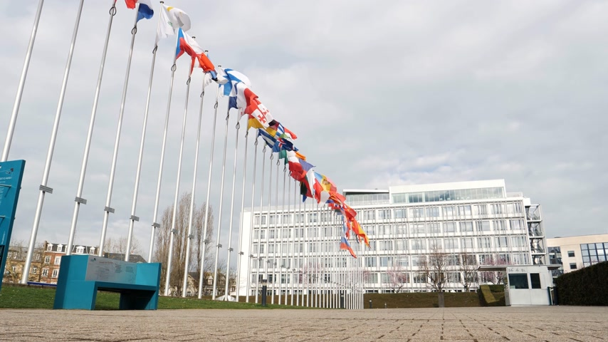 national day of mourning : STRASBOURG, FRANCE - MAR 29, 2018: Low angle of Council of Europe building with Flag of Russia flying half-mast as tribute and mourning of victims of fire at Zimnyaya Vishnya shopping centre Kemerovo