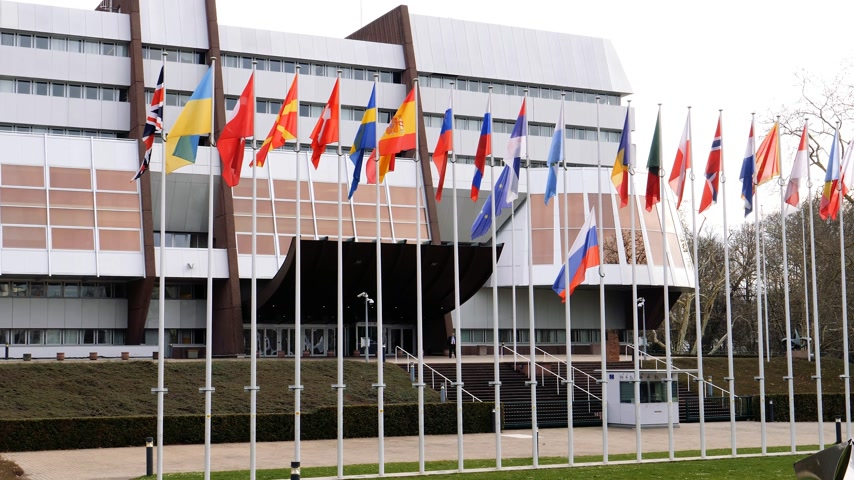 national day of mourning : STRASBOURG, FRANCE - MAR 29, 2018: Facade of Council of Europe building with Flag of Russia flying half-mast as tribute and mourning of victims of fire at shopping centre Kemerovo Stock Footage