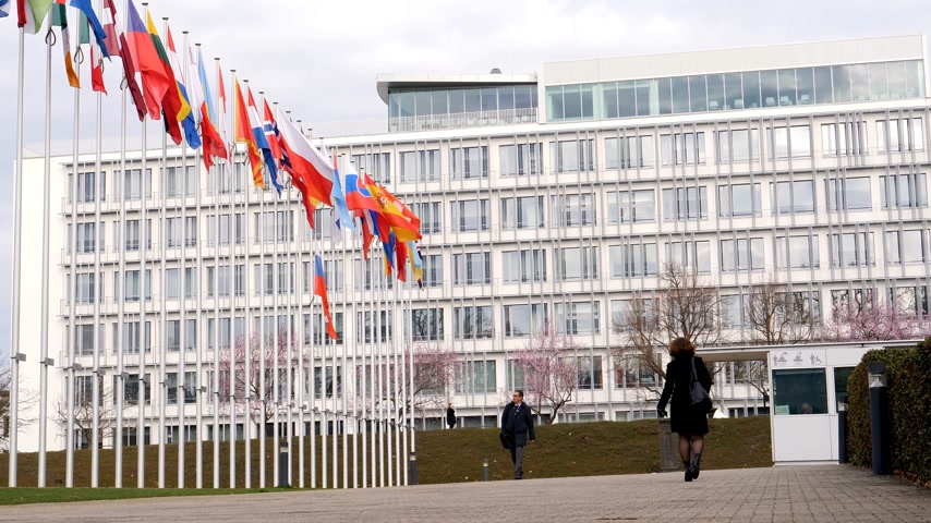 flag half mast : STRASBOURG, FRANCE - MAR 29, 2018: People going to work at Council of Europe with Flag of Russia flying half-mast as tribute and mourning of victims of fire at shopping centre Kemerovo