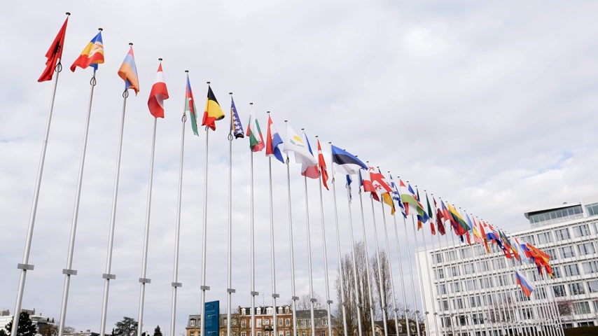 flag half mast : STRASBOURG, FRANCE - MAR 28, 2018: Flag of Russia flying half-mast next to all European Flags at Council of Europe - tribute and mourning of victims of fire at Zimnyaya Vishnya shopping centre