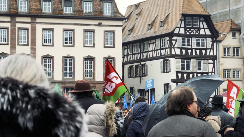 nationwide : STRASBOURG, FRANCE  - MAR 22, 2018: Crowd with flags in Place Kleber at demonstration protest against Macron French government string of reforms, trade unions of public workers to strike