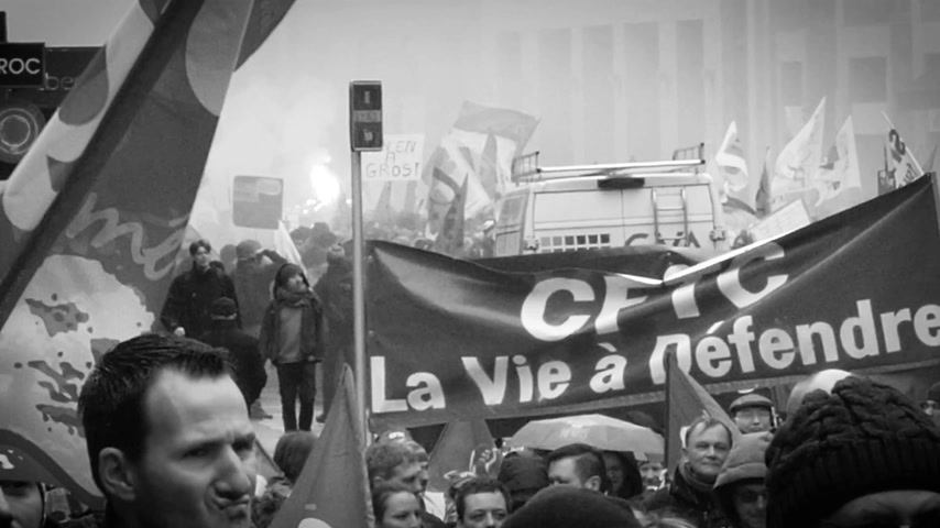 nationwide : STRASBOURG, FRANCE - MAR 22, 2018: Smoke grenade between crowd - workers holding placards at demonstration protest against Macron French government string of reforms
