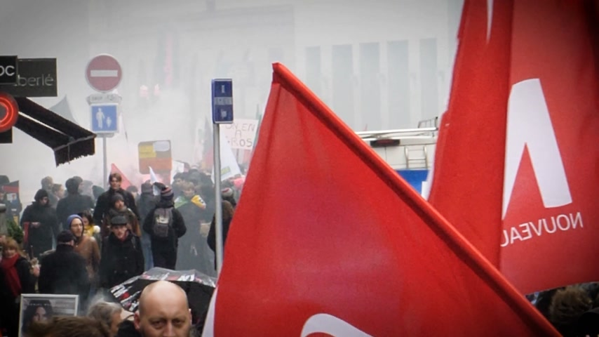 syndicate : STRASBOURG, FRANCE - MAR 22, 2018: Smoke grenade between crowd - workers holding placards at demonstration protest against Macron French government string of reforms