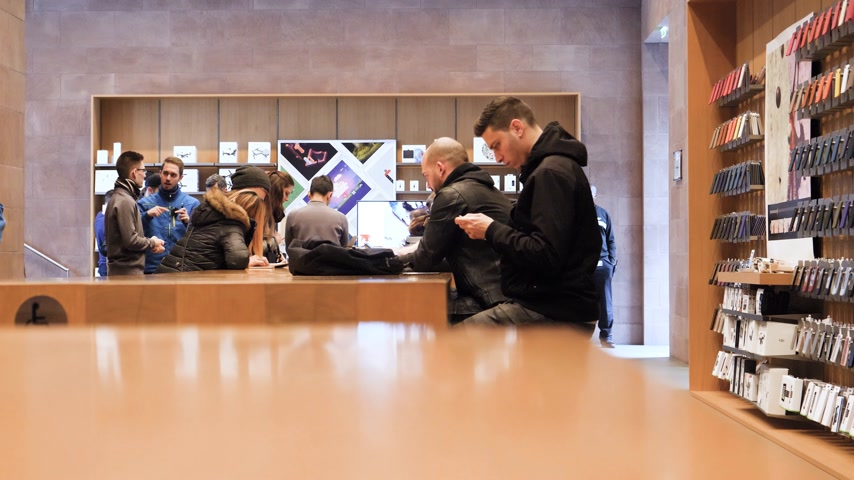 apple workstation : STRASBOURG, FRANCE - JAN 12, 2018: People waiting for genius appointment at Apple Service Store to repair iPhone smartphones and Apple Computers Laptops