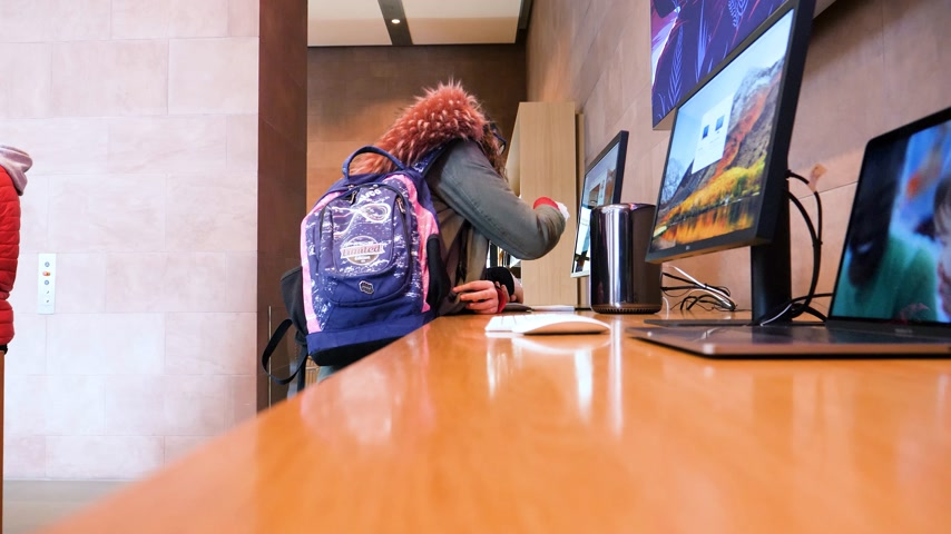 intel : STRASBOURG, FRANCE - JAN 12, 2018: Funny girls using Mac Pro computer in Apple Computers Store Stock Footage