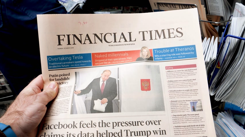 authoritarian state : PARIS, FRANCE - MAR 19, 2017: reading buying British Financial Times newspaper at press kiosk featuring Russian presidential election from 2018 with the winner Vladimir Putin