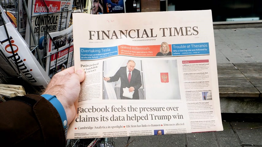 authoritarian state : PARIS, FRANCE - MAR 19, 2017: Man reading buying British Financial Times newspaper at press kiosk featuring Russian presidential election from 2018 with the winner Vladimir Putin Stock Footage
