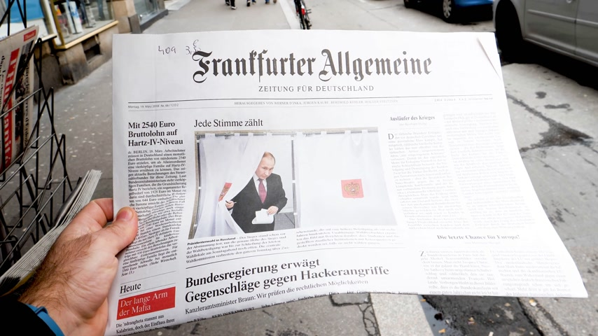 authoritarian state : PARIS, FRANCE - MAR 19, 2017: German Frankfurter Allgemeine Zeitung newspaper at press kiosk featuring Russian presidential election from 2018 with the winner Vladimir Putin