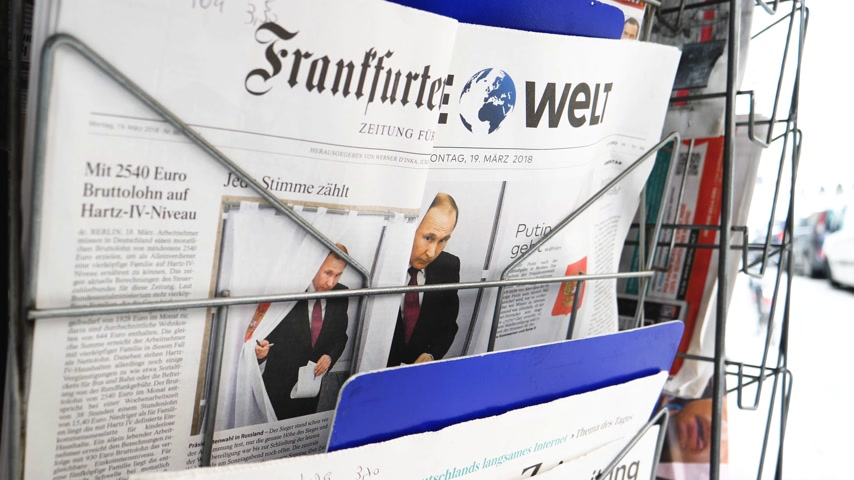 authoritarian state : PARIS, FRANCE - MAR 19, 2017: German Frankfurter Allgemeine Zeitung and Die Welt newspapers at press kiosk featuring Russian presidential election from 2018 with the winner Vladimir Putin