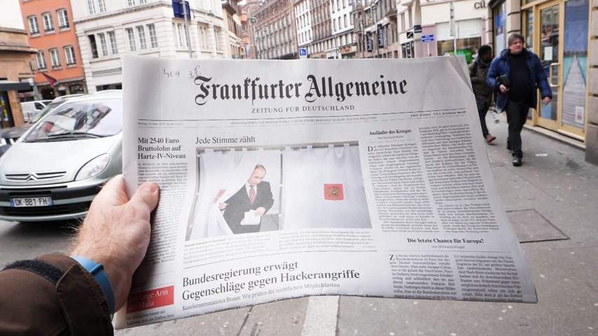 authoritarian state : PARIS, FRANCE - MAR 19, 2017: Man reading buying German Frankfurter Allgemeine Zeitung newspaper at press kiosk featuring Russian presidential election from 2018 with the winner Vladimir Putin slow motion Stock Footage