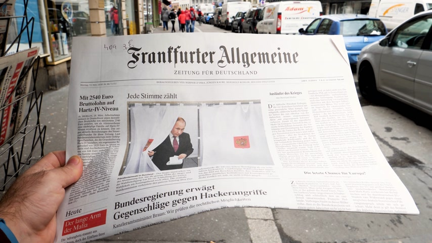 authoritarian state : PARIS, FRANCE - MAR 19, 2017: Man reading buying German Frankfurter Allgemeine Zeitung newspaper at press kiosk featuring Russian presidential election from 2018 with the winner Vladimir Putin