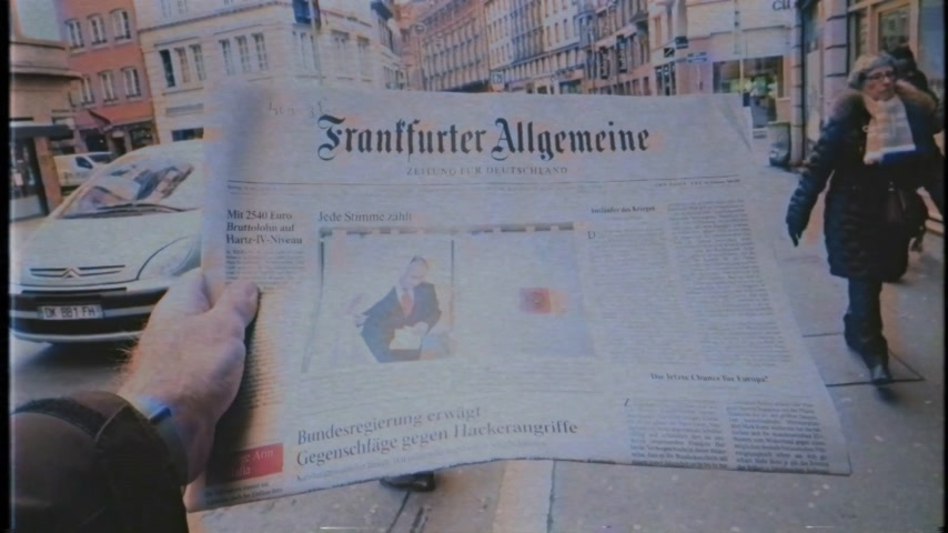 authoritarian state : PARIS, FRANCE - MAR 19, 2017: Man reading buying German Frankfurter Allgemeine Zeitung newspaper  featuring Russian presidential election from 2018 with the winner Vladimir Putin slow motion
