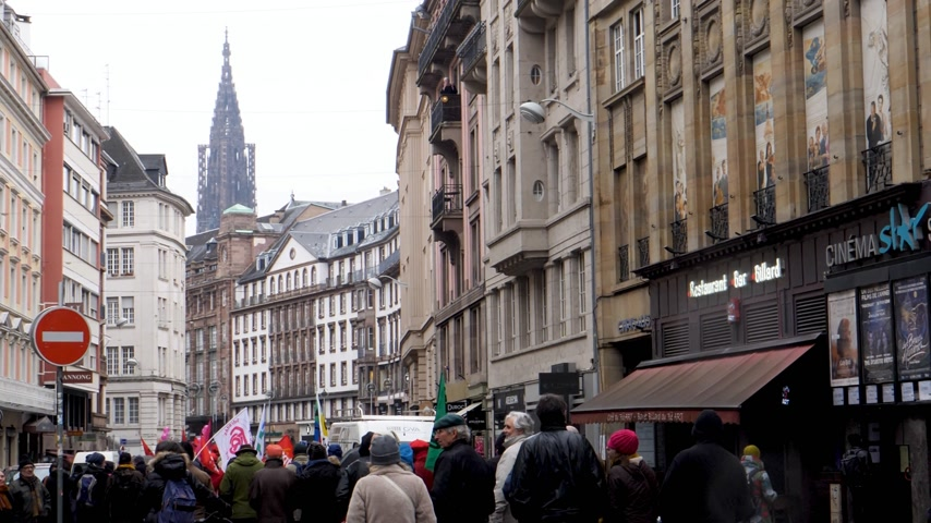 anti macron : STRASBOURG, FRANCE - MAR 22, 2018: Strasbourg Cathedral and street with general nationwide protest of workers at demonstration protest against Macron French government string of reforms