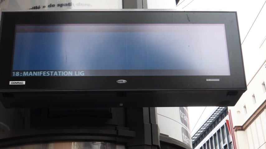 anti macron : STRASBOURG, FRANCE - MAR 22, 2018: Tramway display information with traffic delayed due to general nationwide protest of workers  against Macron French government string of reforms Stock Footage