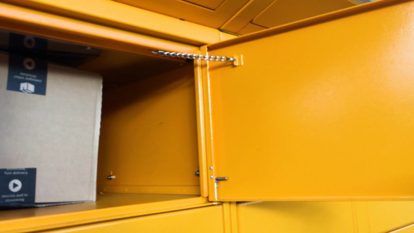 amazon prime : PARIS, FRANCE - FEB 15, 2017: Senior male opening door of the Amazon Locker orange delivery parcel package locker Amazon Locker is a self-service parcel delivery service offered by online retailer Amazon.com. Amazon customers can select any Locker locatio