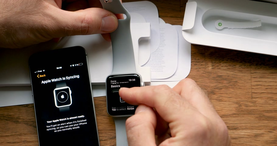jel : PARIS, FRANCE - CIRCA 2018: POV man unboxing unpacking latest Apple Watch Series 3 GPS LTE smartwatch wearable computer - settings for side crown, display and side button Stock mozgókép