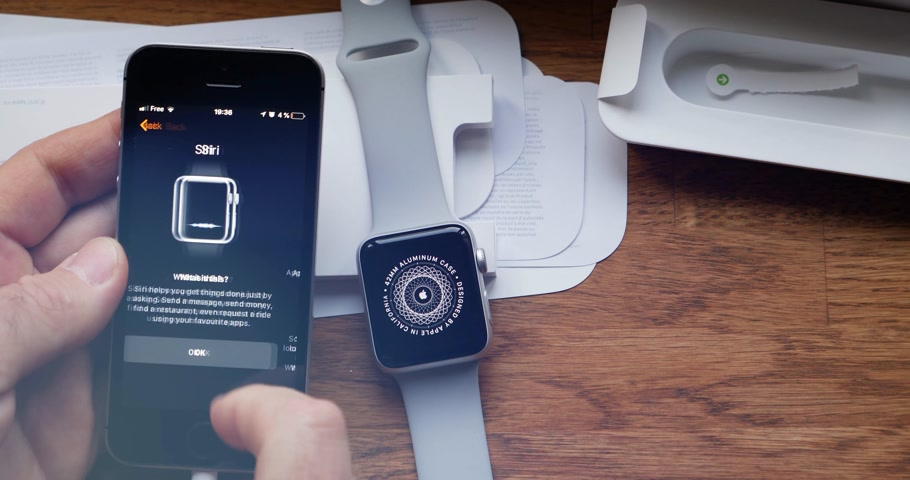 jel : PARIS, FRANCE - CIRCA 2018: POV man unboxing unpacking latest Apple Watch Series 3 GPS LTE smartwatch wearable computer timelapse with flare Stock mozgókép
