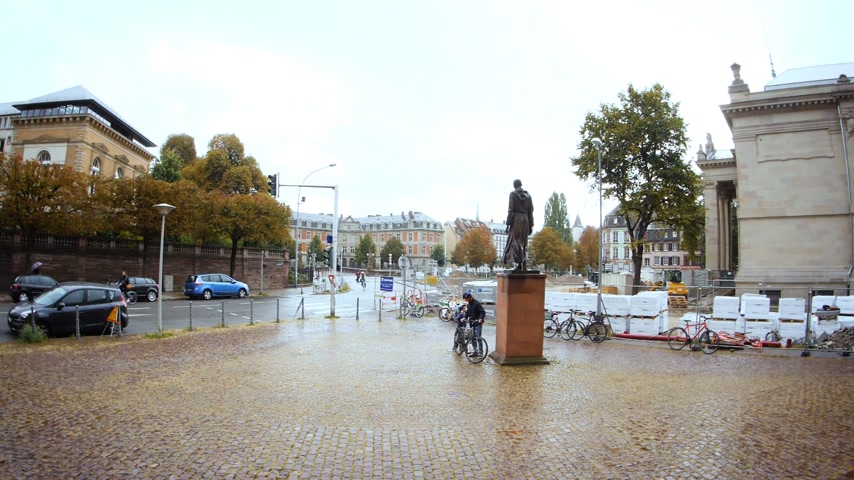 tribunal : STRASBOURG, FRANCE - CIRCA 2018: Place Charles-de-Foucauld in central Strasbourg, with the view to the High Court Tribunal de Grande Instance building - heavy rain