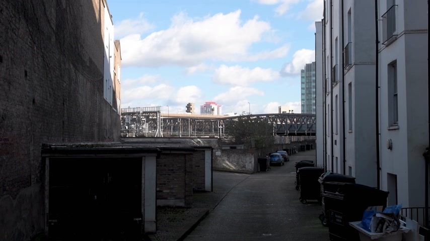 westminster : Lord Hills Bridge W2 in City of Westminster highway with Gaydon House in the background seen through buildings and trash cans
