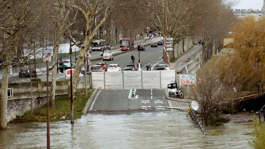 boathouse : PARIS, FRANCE - JAN 30, 2018: Closed New York boulevard Avenue in Paris during overflow flooding embankments on the Seine river after heavy rain - cars driving pedestrians commuting
