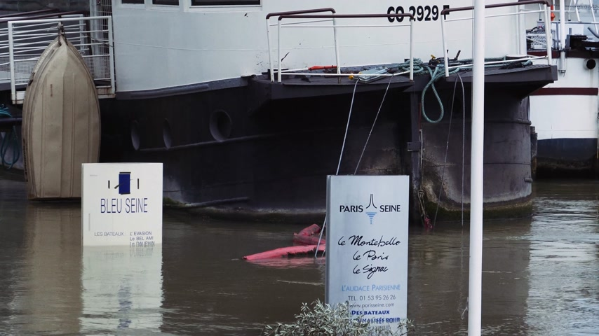 boathouse : PARIS, FRANCE - JAN 30, 2018: Flooded Seine in Paris with covered signs  after heavy rains with Eiffel Tower in the background Stock Footage