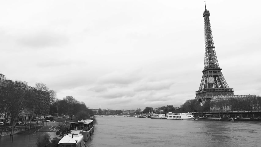 boathouse : Flooding in Paris - black and white footage with houseboat barge peniche on the overflow flooding embankments on the Seine river in Paris after heavy rains with Eiffel Tower in the background - news footage aerial still drone Stock Footage