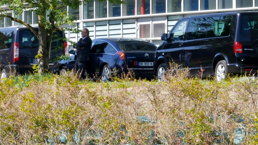 citroen : STRASBOURG, FRANCE - APR 17, 2018: Drivers waiting near limousines convoy of the Emmanuel Macron, President of France during the visit at the European Parliament - sunny day Parliament facade