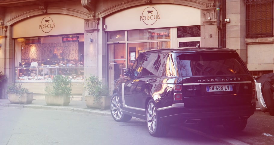 neuf : STRASBOURG, FRANCE - 13 MAR, 2018: Range Rover Land Rover Vogue, the luxury British SUV parked in central French street near butcher shop Porcus Place du Temple Neuf - cinematic flare