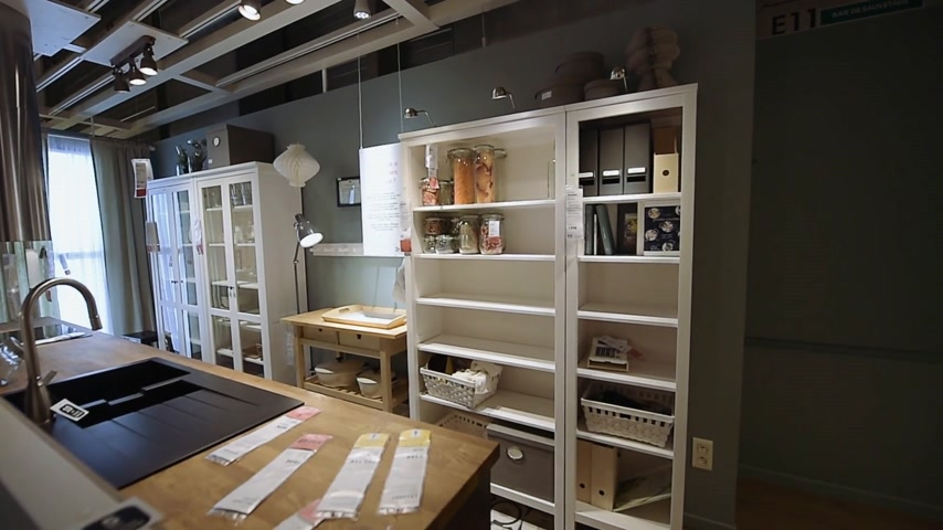 ikea : PARIS, FRANCE - CIRCA 2018: Modern IKEA furniture store woman customer browsing through diverse furniture, decoration warehouse goods - new kitchen furniture with all the accessories