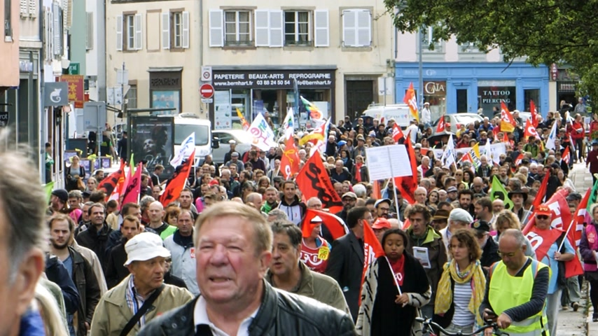 nationwide : STRASBOURG, FRANCE - SEP 12, 2018: Thousands marching on French street at French Nationwide day of protest against labor reform proposed by Emmanuel Macron Government