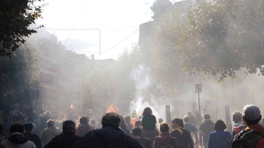 emmanuel macron : STRASBOURG, FRANCE - SEP 12, 2018: Cinematic smoke grenade thrown by people during French Nationwide day of protest against labor reform proposed by Emmanuel Macron Government